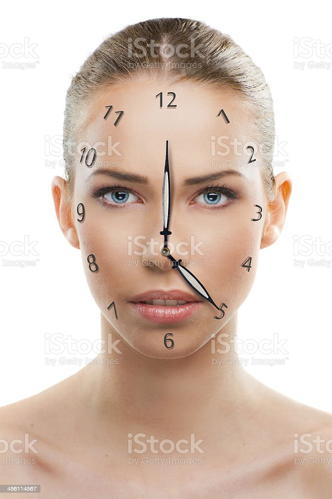 Beautiful woman close up with a clock over white background stock photo