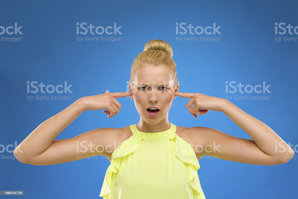 Beautiful woman closes her ears. royalty-free stock photo