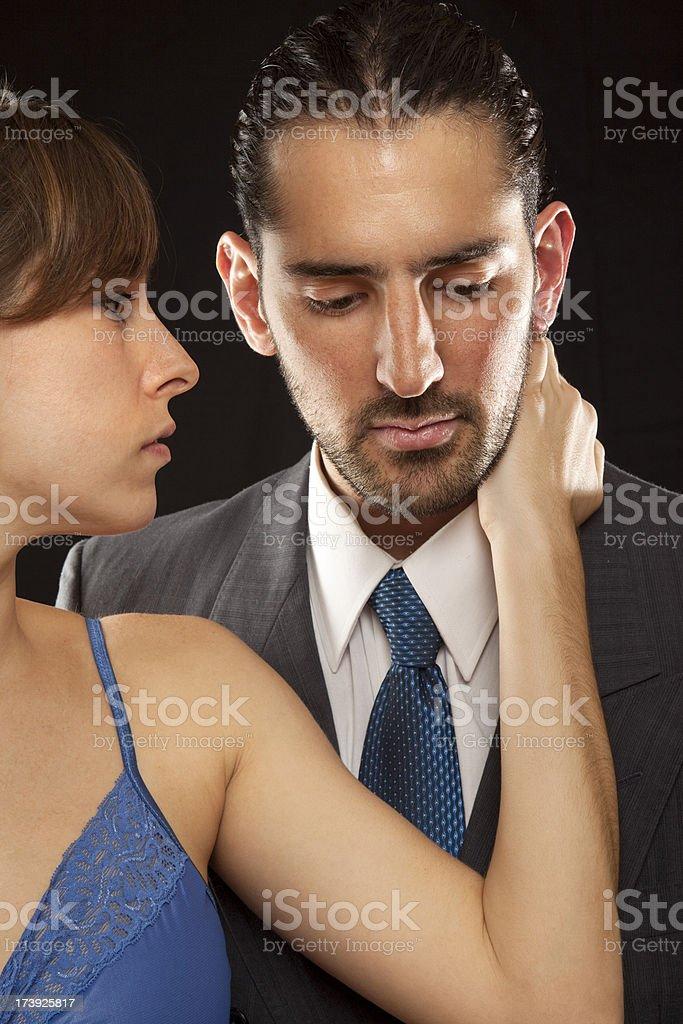 Beautiful woman comforting man stock photo