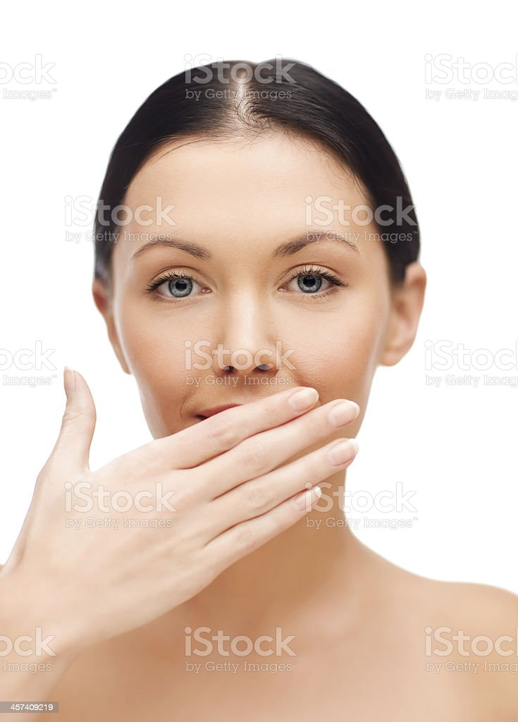 beautiful woman covering her mouth royalty-free stock photo