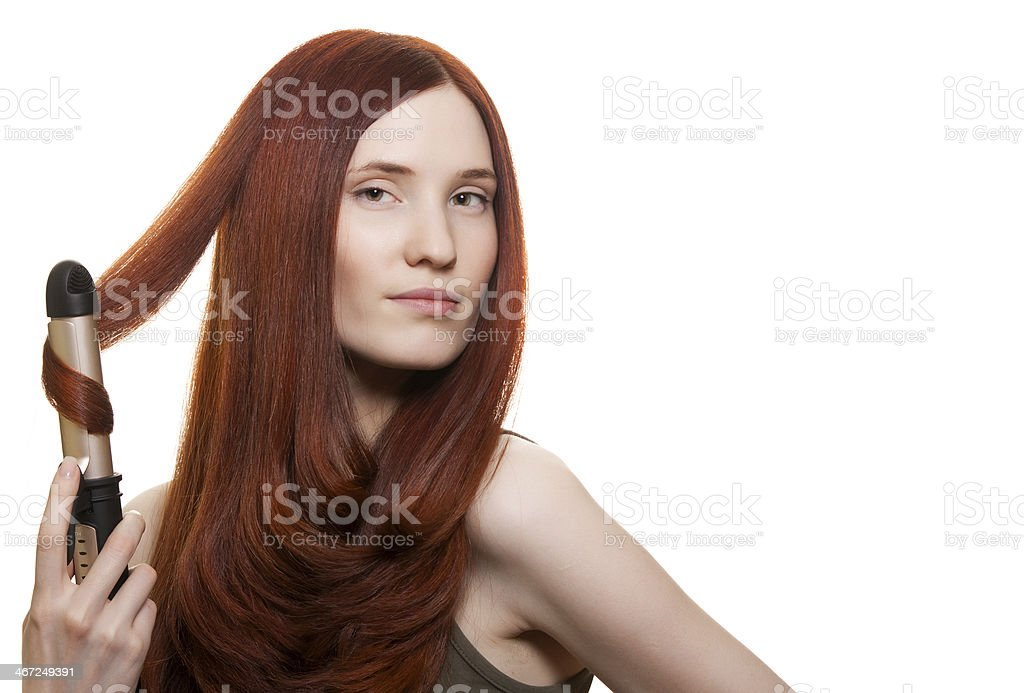 Beautiful woman curling long hair isolated stock photo