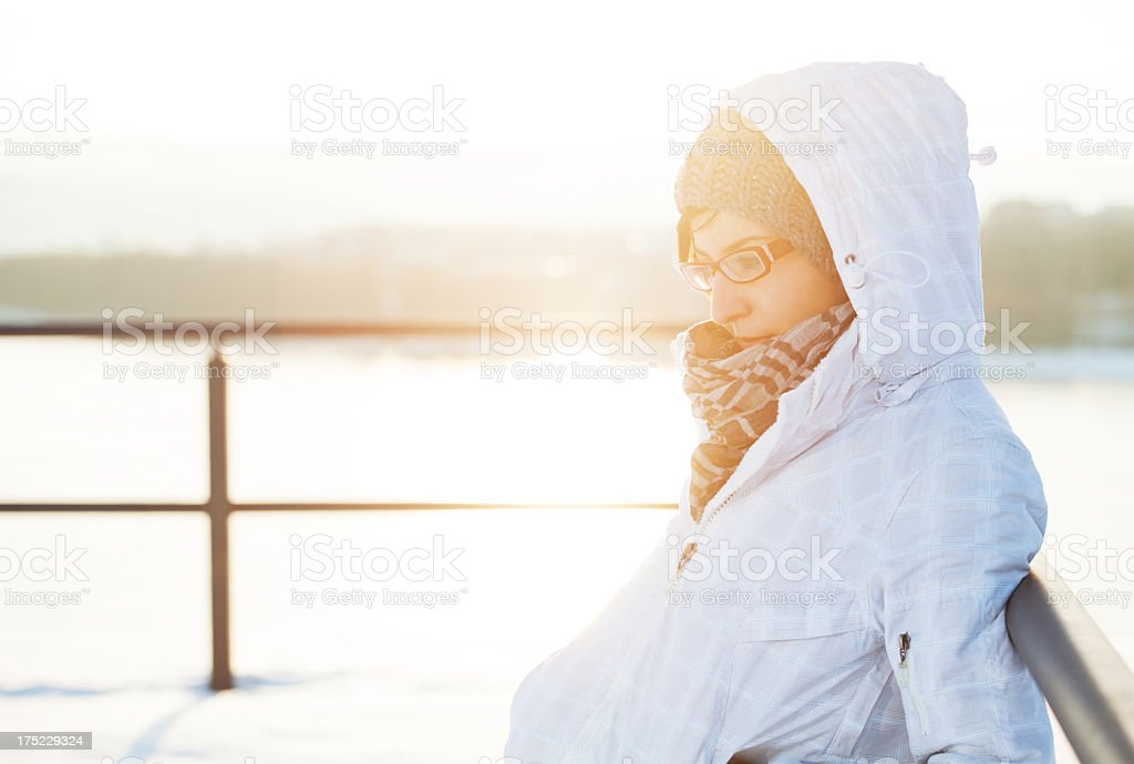 Beautiful woman daydreaming on the snow day royalty-free stock photo