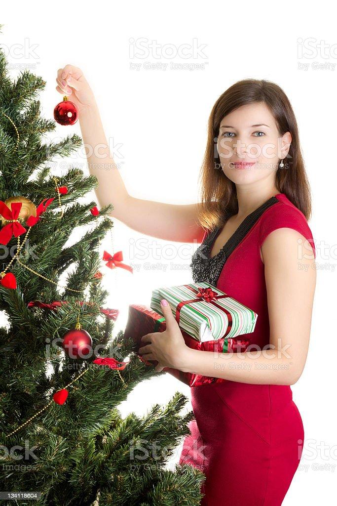 Beautiful woman decorationg Christmas tree stock photo