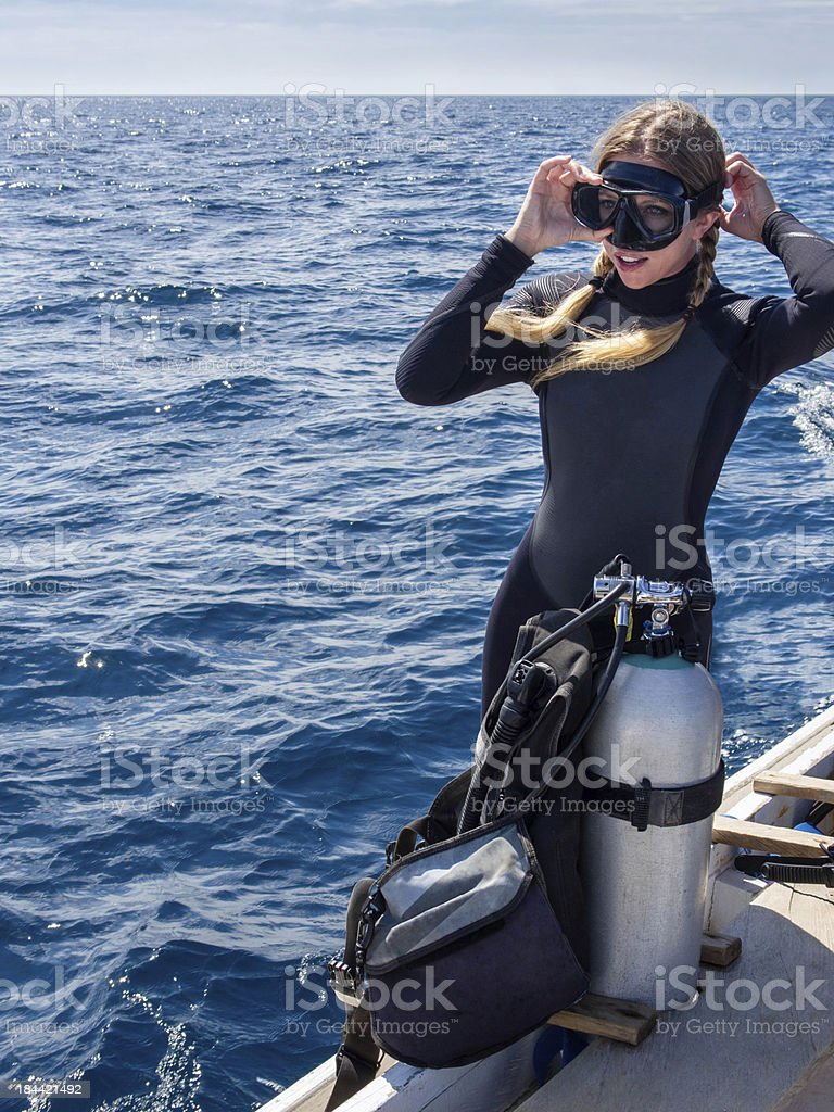 Beautiful Woman Diver in Preparation for Scuba Diving stock photo