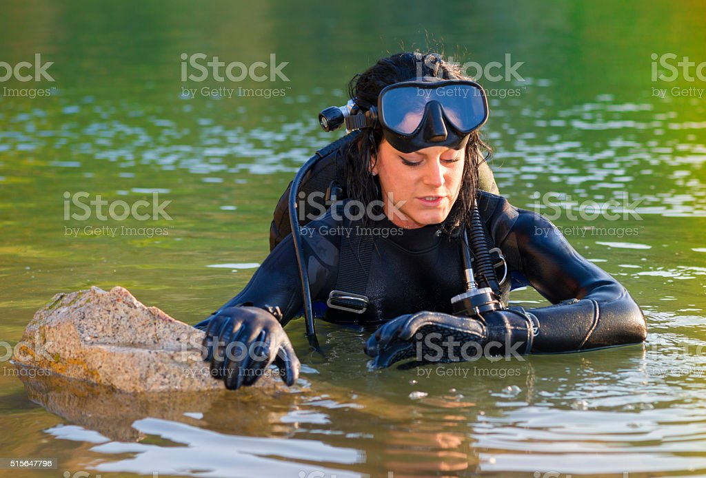Beautiful woman diver stock photo