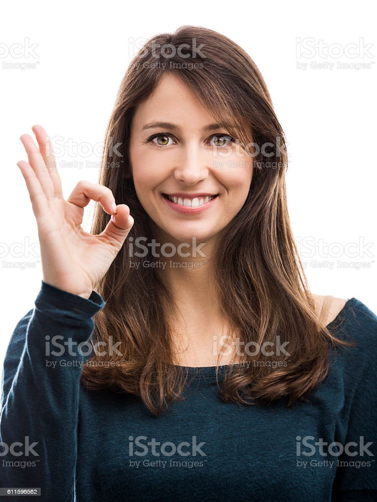 Beautiful woman doing a OK signal with her hand stock photo
