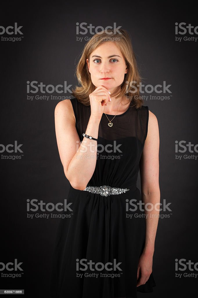 Beautiful woman doing different expressions in different sets of clothes: thinking stock photo