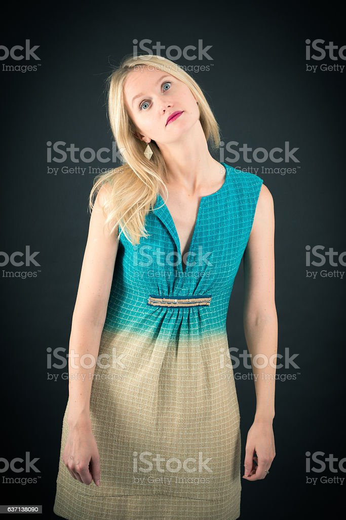 Beautiful woman doing different expressions in different sets of clothes: bored stock photo