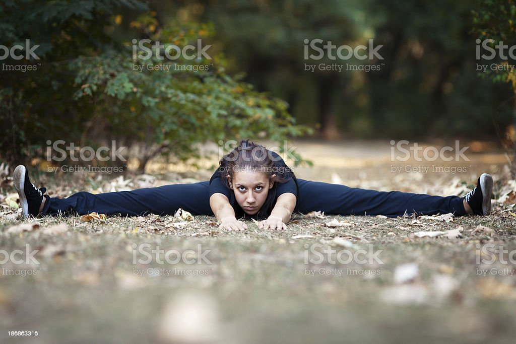 Beautiful woman doing split royalty-free stock photo