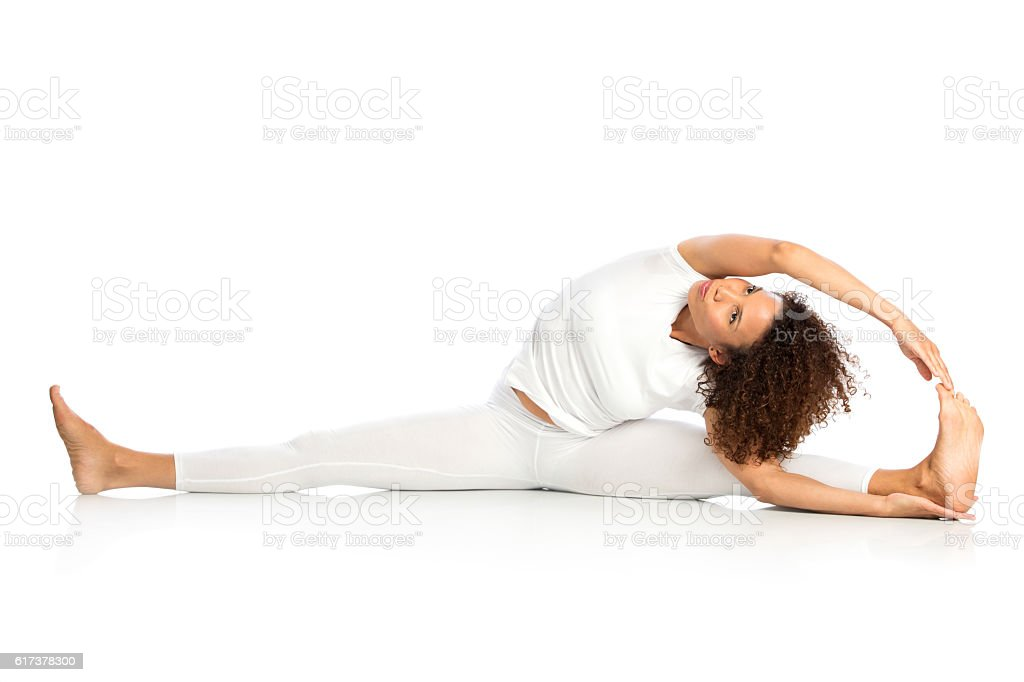 Beautiful woman doing stretches, isolated on white stock photo