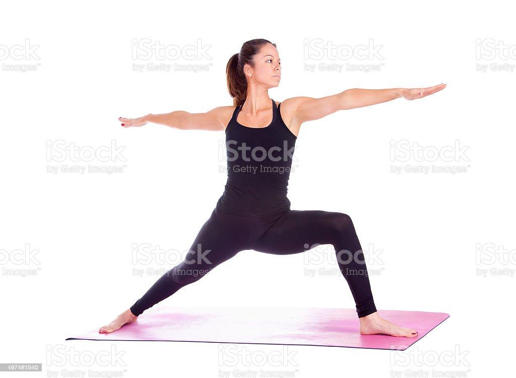 Beautiful woman doing Virabhadrasana 2 pose stock photo