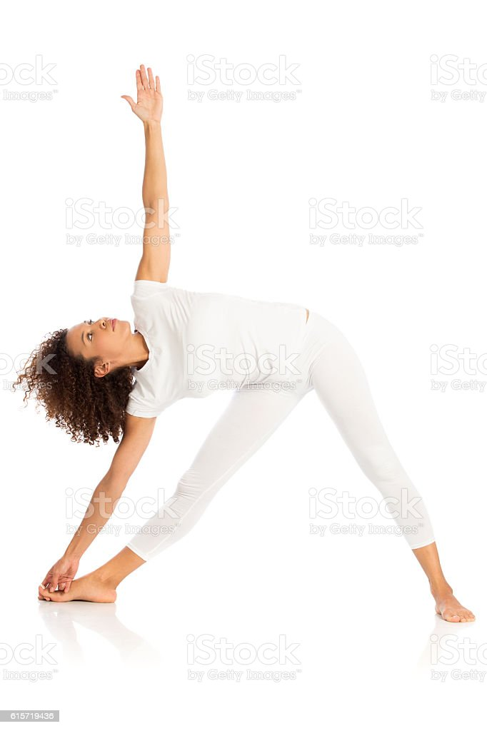 Beautiful woman doing yoga, isolated on white stock photo