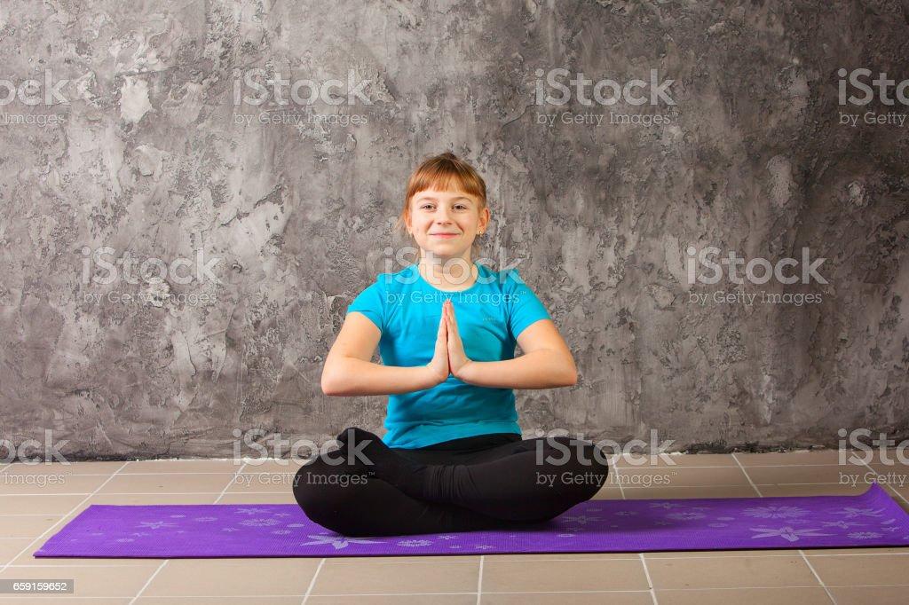 beautiful woman doing yoga on gray background stock photo