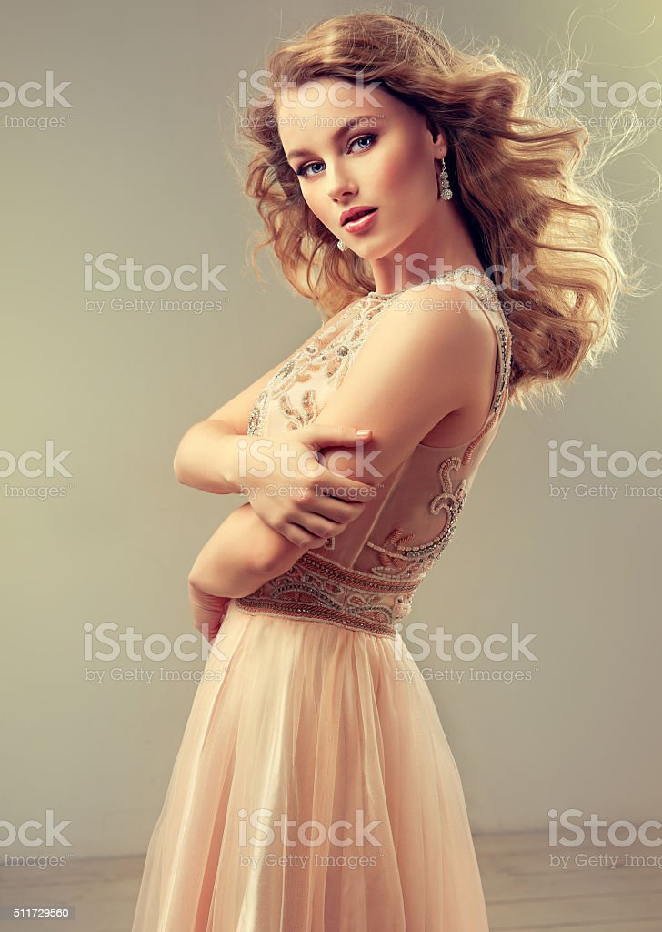 Beautiful woman, dressed in evening gown. Spring mood. stock photo