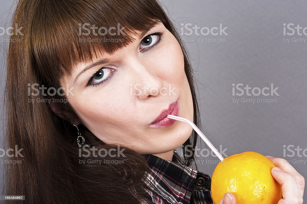 beautiful woman drinking royalty-free stock photo