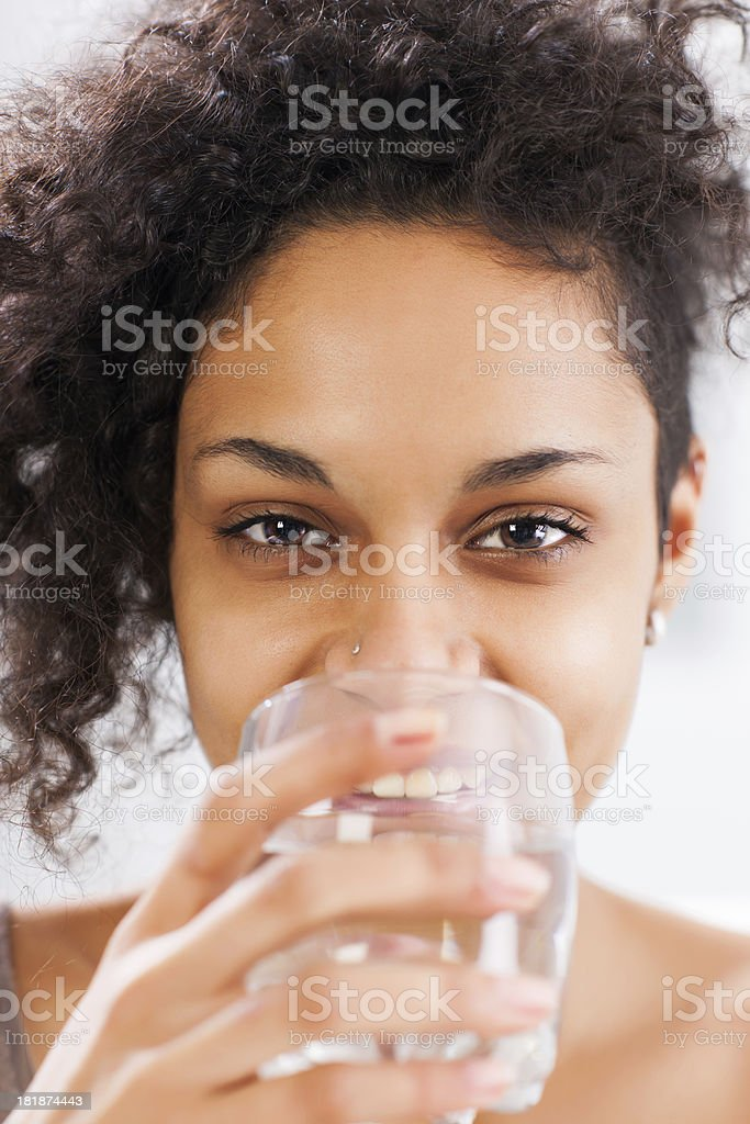 Beautiful woman drinking water. royalty-free stock photo