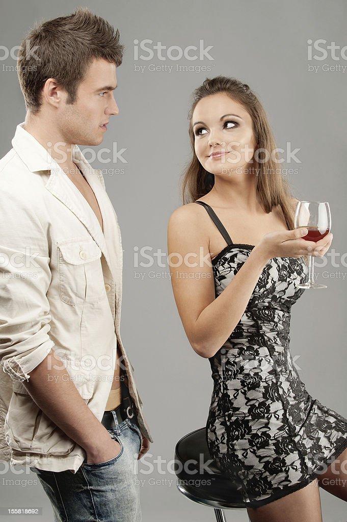 Beautiful woman drinks wine and man royalty-free stock photo