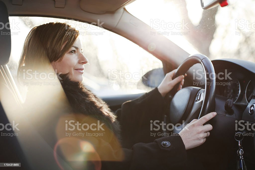 Beautiful woman driving a car. royalty-free stock photo