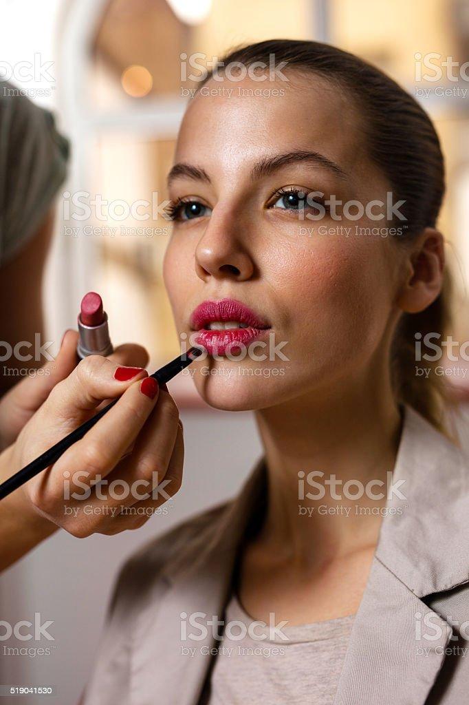 Beautiful woman during make-up treatment. stock photo