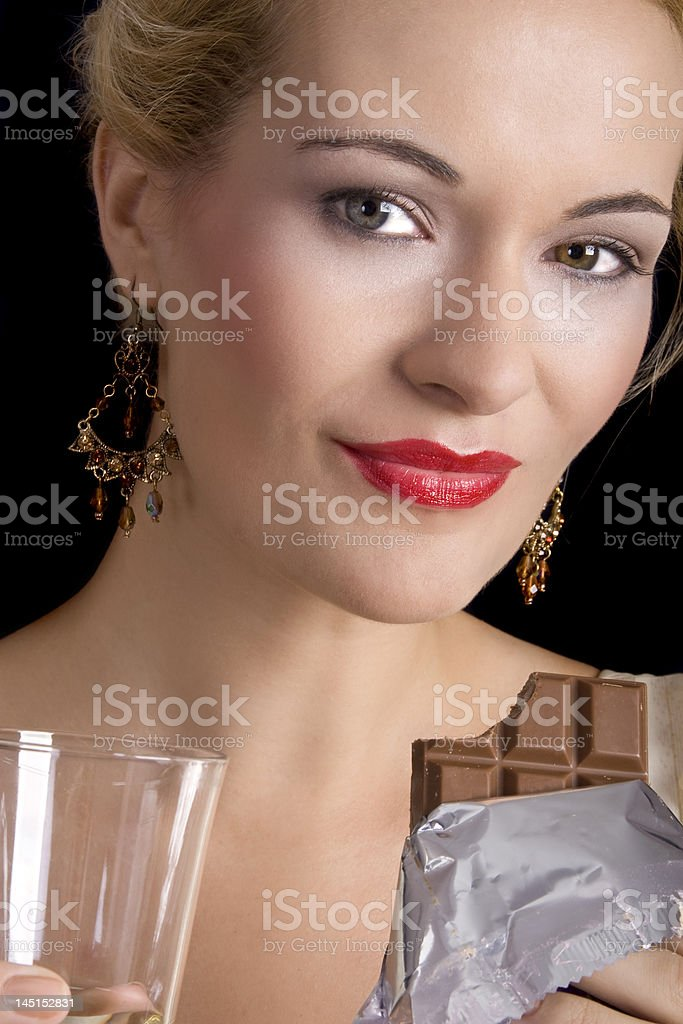 Beautiful woman eating chocolate royalty-free stock photo