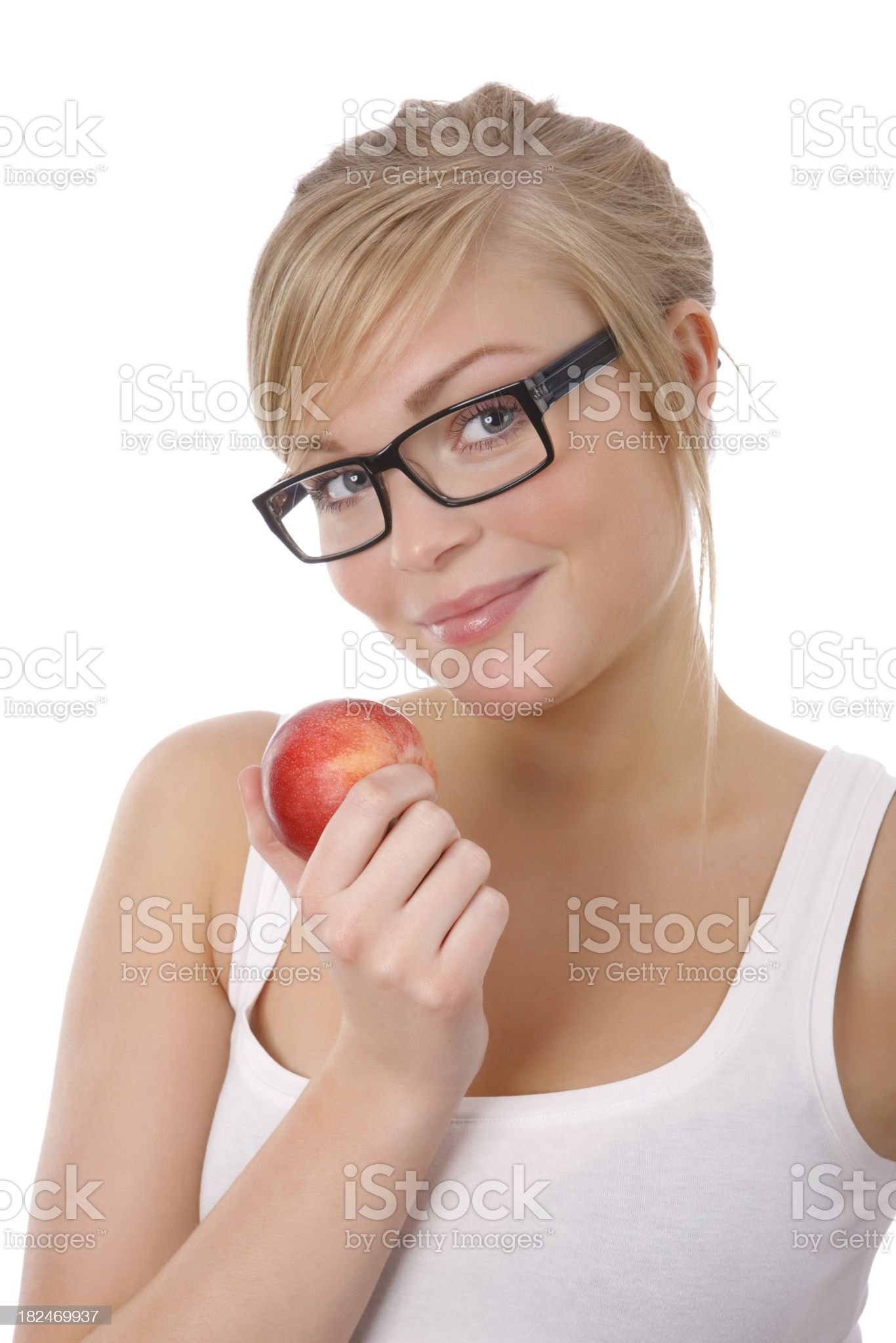 Beautiful Woman Eats an Apple royalty-free stock photo