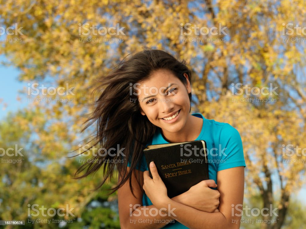 Beautiful woman embracing the Bible royalty-free stock photo