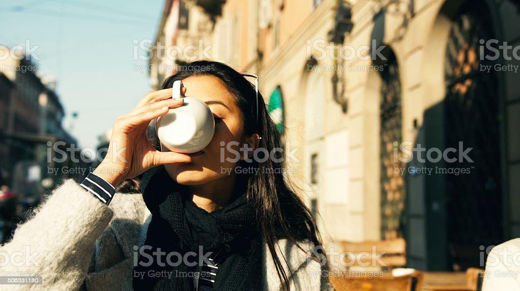 Beautiful woman enjouing coffee stock photo