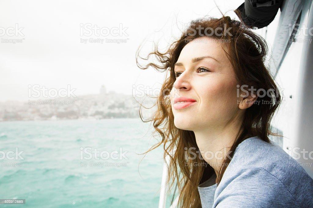 Beautiful woman enjoying a cruise on the bosphorus stock photo