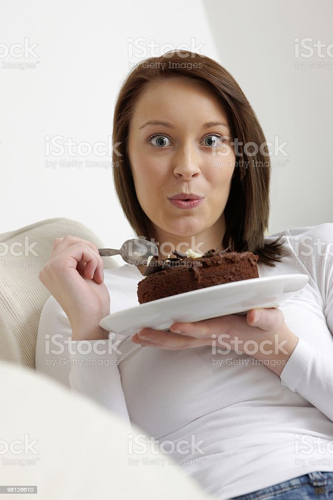 Beautiful woman enjoying a delicious dessert at home royalty-free stock photo