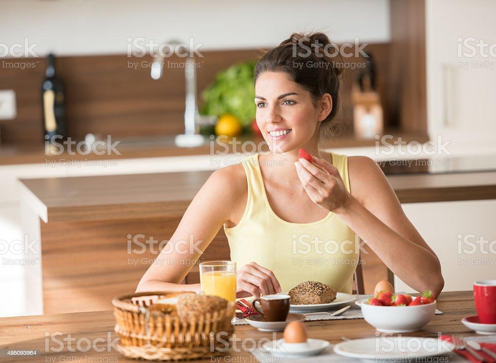 Beautiful Woman enjoying a healthy Breakfast stock photo