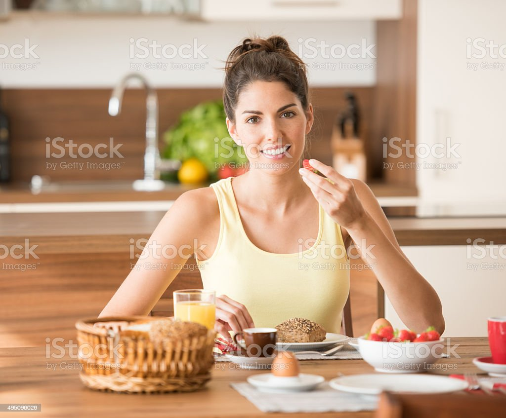 Beautiful Woman enjoying a healthy Breakfast stock photo