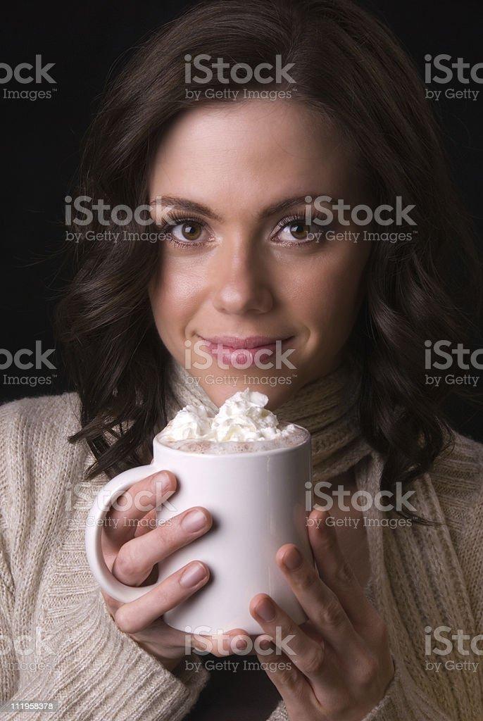 Beautiful woman enjoying hot chocolate on black background stock photo