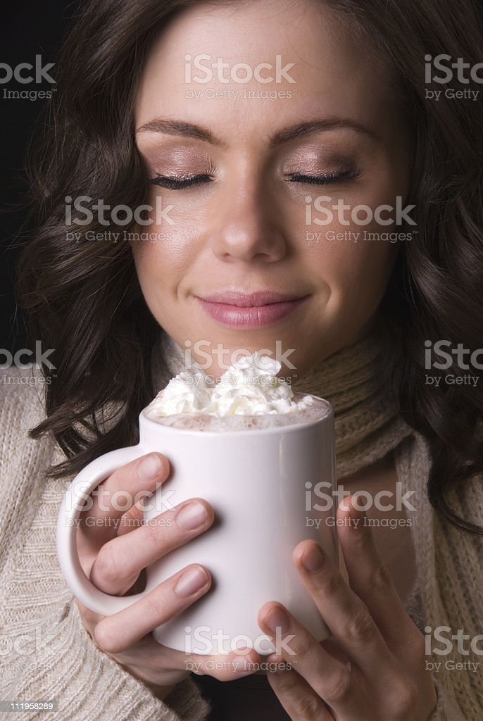 Beautiful woman enjoying hot chocolate stock photo