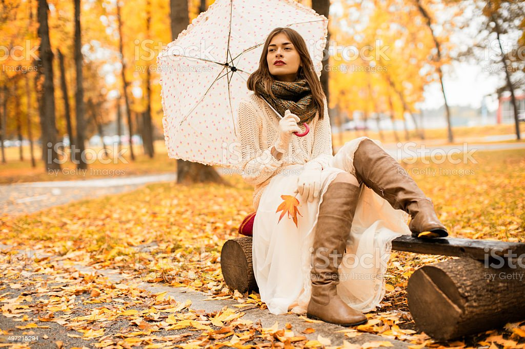 Beautiful woman enjoying in autumn stock photo