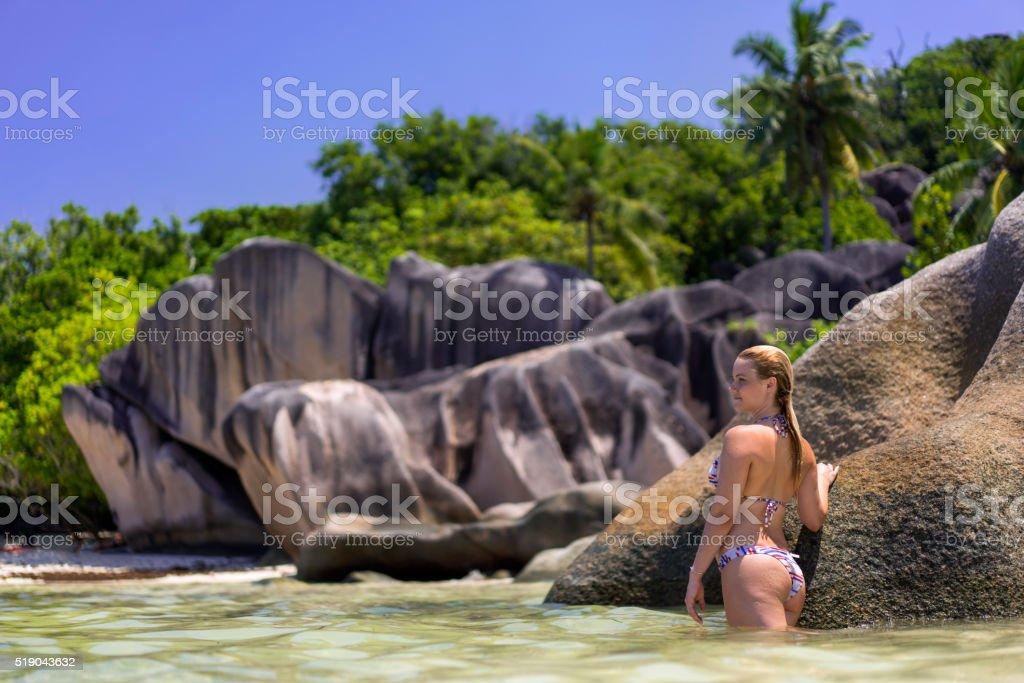 Beautiful woman enjoying in summer day at sea. stock photo