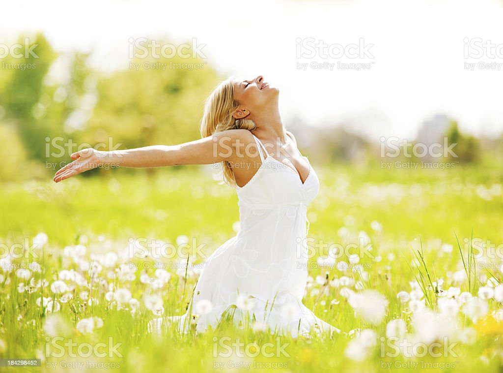 Beautiful woman enjoying in the nature and fresh air. royalty-free stock photo