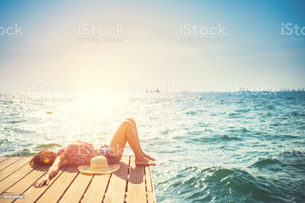 Beautiful woman Enjoying in Thessaloniki,by the sea stock photo