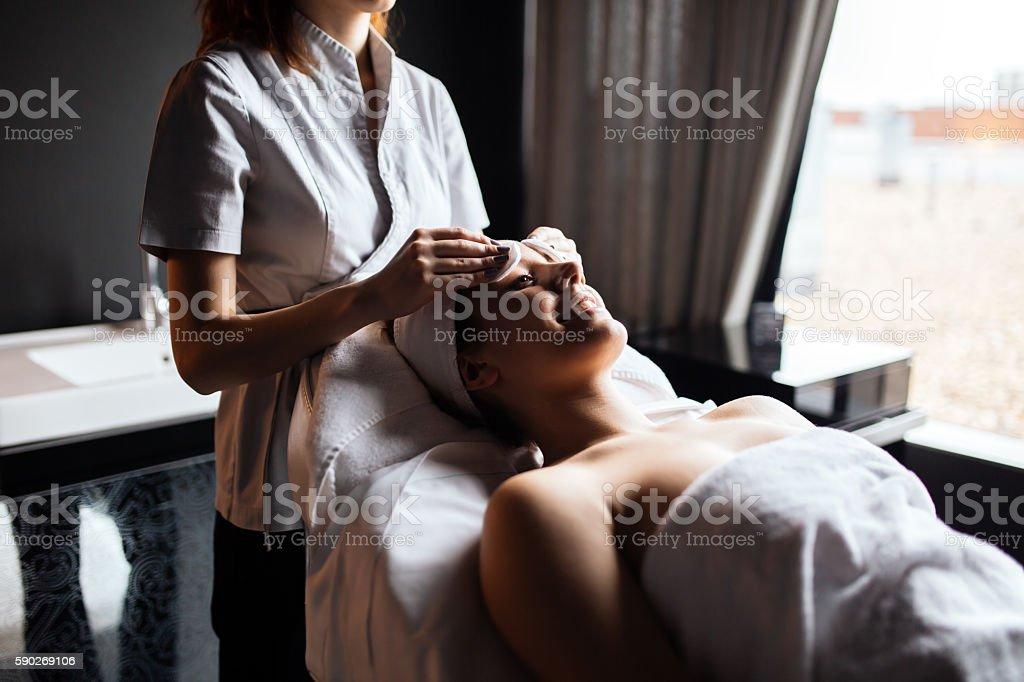 Beautiful woman enjoying massage stock photo