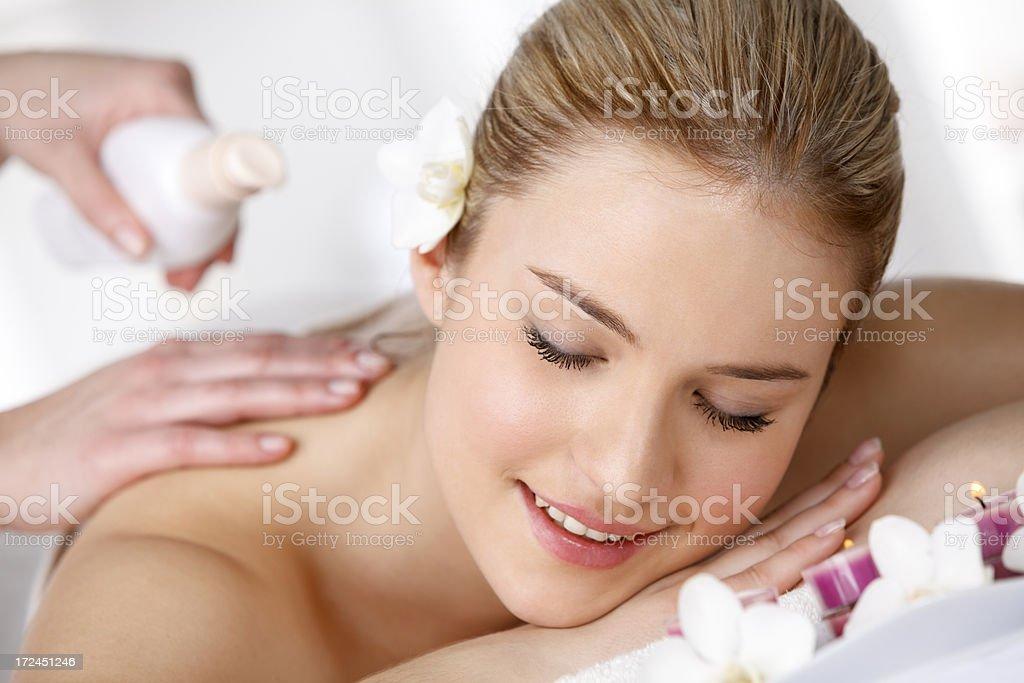 Beautiful woman enjoying receiving massage at spa royalty-free stock photo