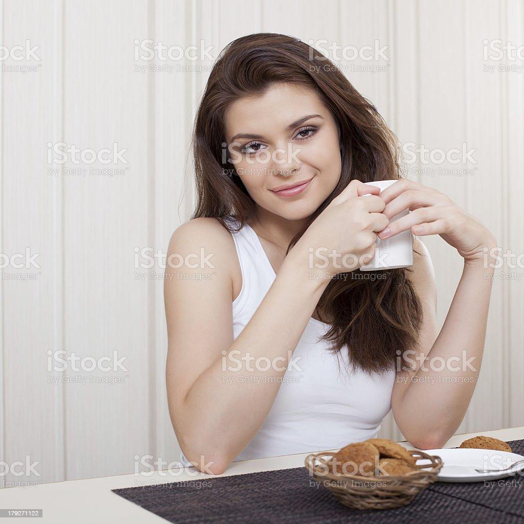 beautiful woman enjoying tea and cookies royalty-free stock photo