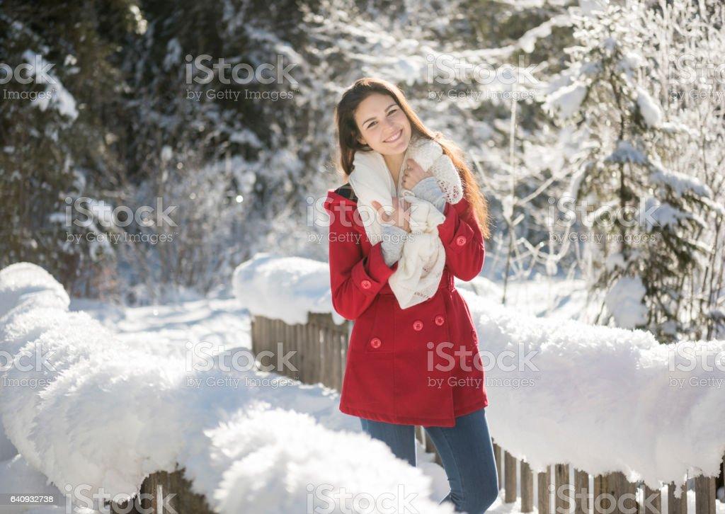 Beautiful woman enjoying this wonderful winter day stock photo