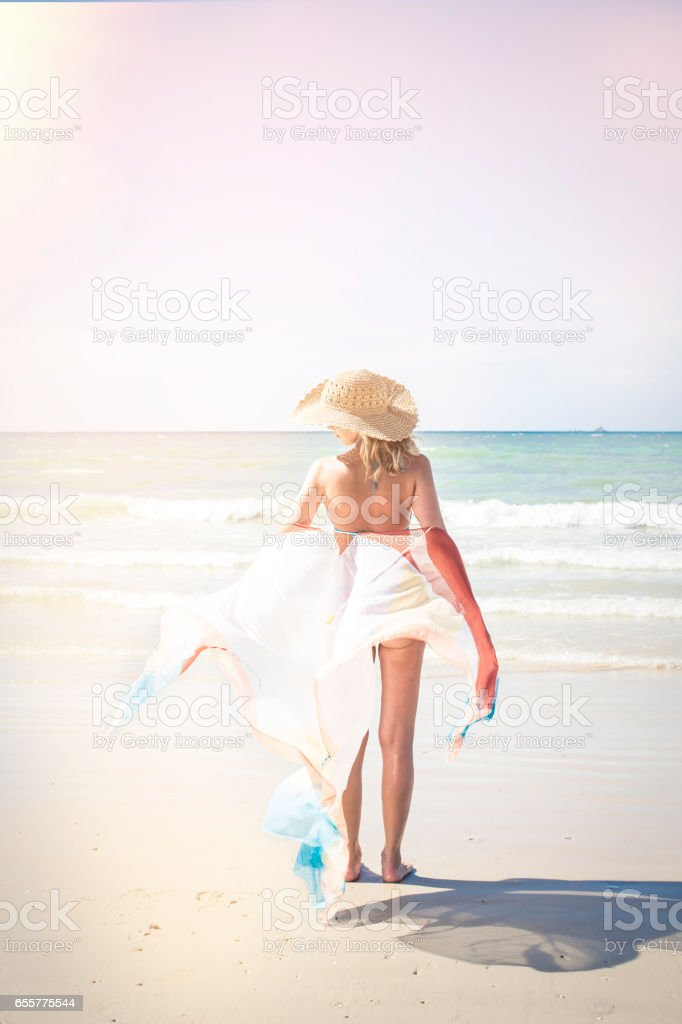 Beautiful woman enjoys the beach, thailand, phuket stock photo
