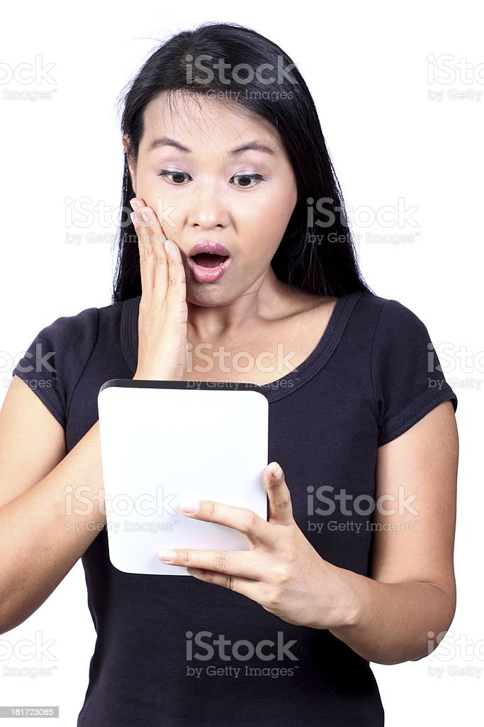 beautiful woman excited looking at touch pad pc royalty-free stock photo