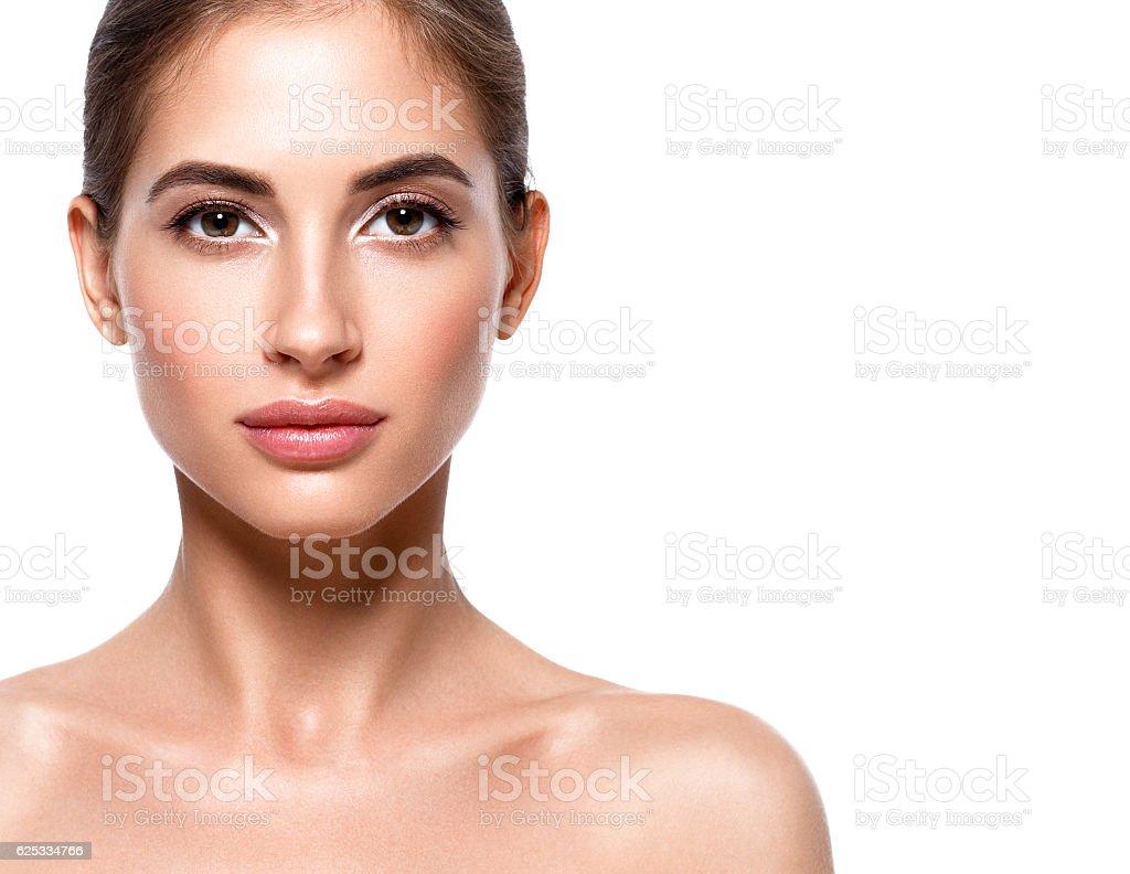 Beautiful woman face close up portrait. Studio shot. stock photo