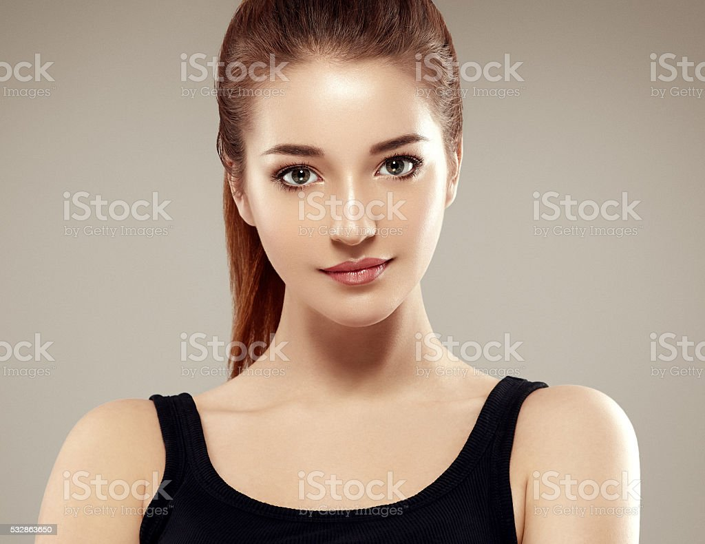 Beautiful woman face close up portrait young studio stock photo