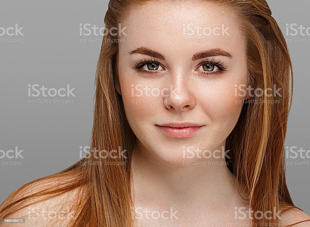 Beautiful woman face close up portrait young with red hair stock photo