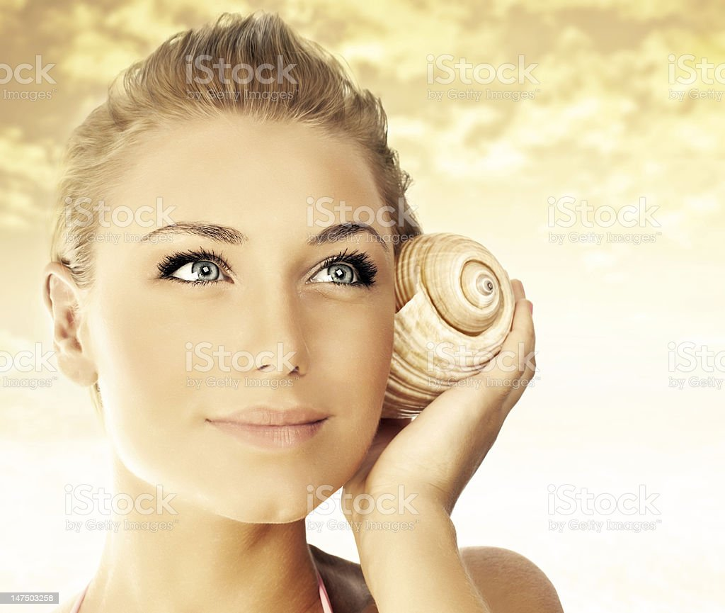 Beautiful woman face over beach sunset royalty-free stock photo