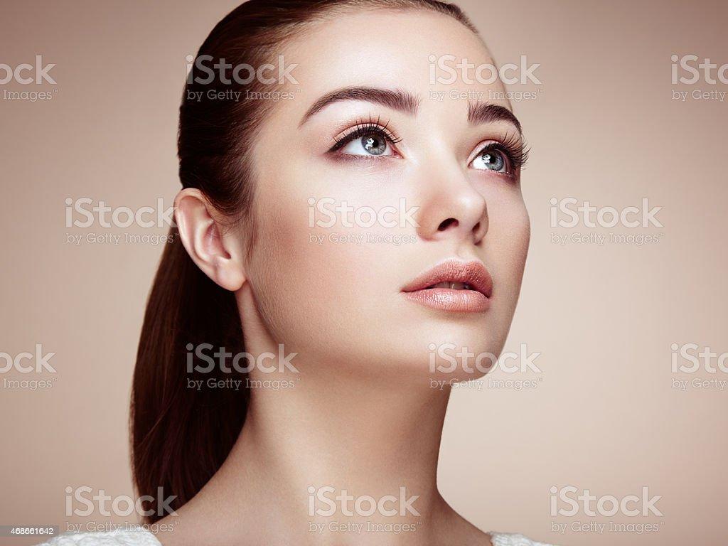 Beautiful woman face. Perfect makeup stock photo