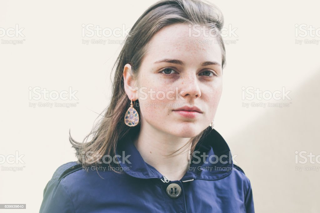 Beautiful woman face portrait freckles street city fashion stock photo