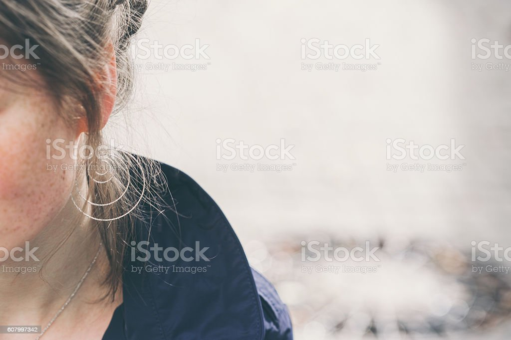 Beautiful woman face portrait freckles street city stock photo